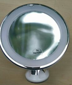 New 7x Magnifying LED illuminated vanity makeup mirror with a suction cup