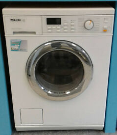 H713 white miele 5kg 1600spin washer dryer comes with warranty can be delivered or collected