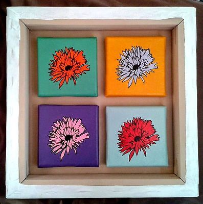 4 small canvases inside 1 larger one