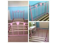 Single pink bed frame next