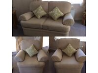 2 seater and 2 arm chairs cream excellent condition