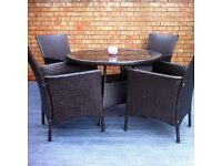 high quality rattan patio set 4 carver chairs,round glass table-rarely used -not cheap plastic set