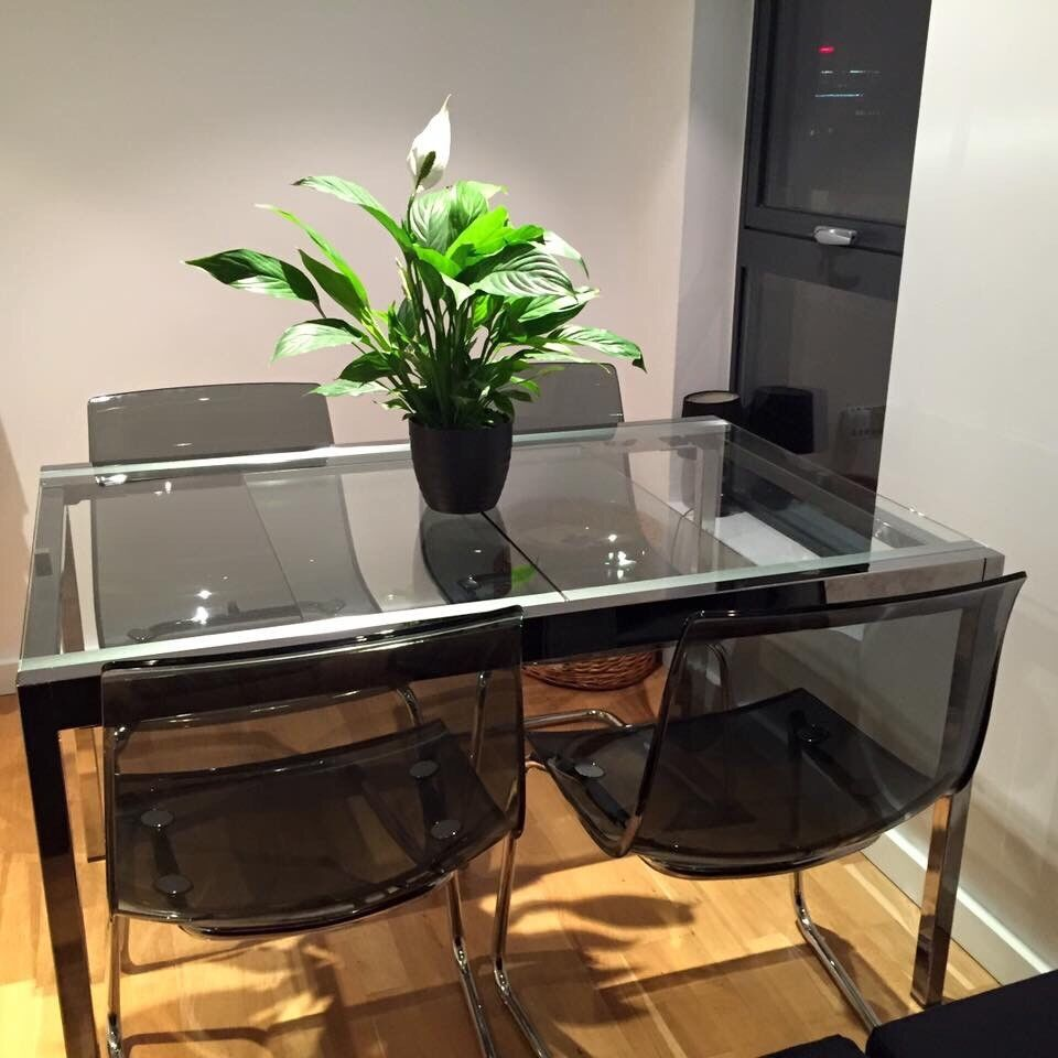 Ikea glass dining table opens up to a 6seater | in Burnage ...