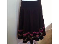 Long brown midi skirt with bold multicoloured embroidery along the hem UK size 10