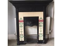 Original Cast Iron Fireplace with tiles and grate.