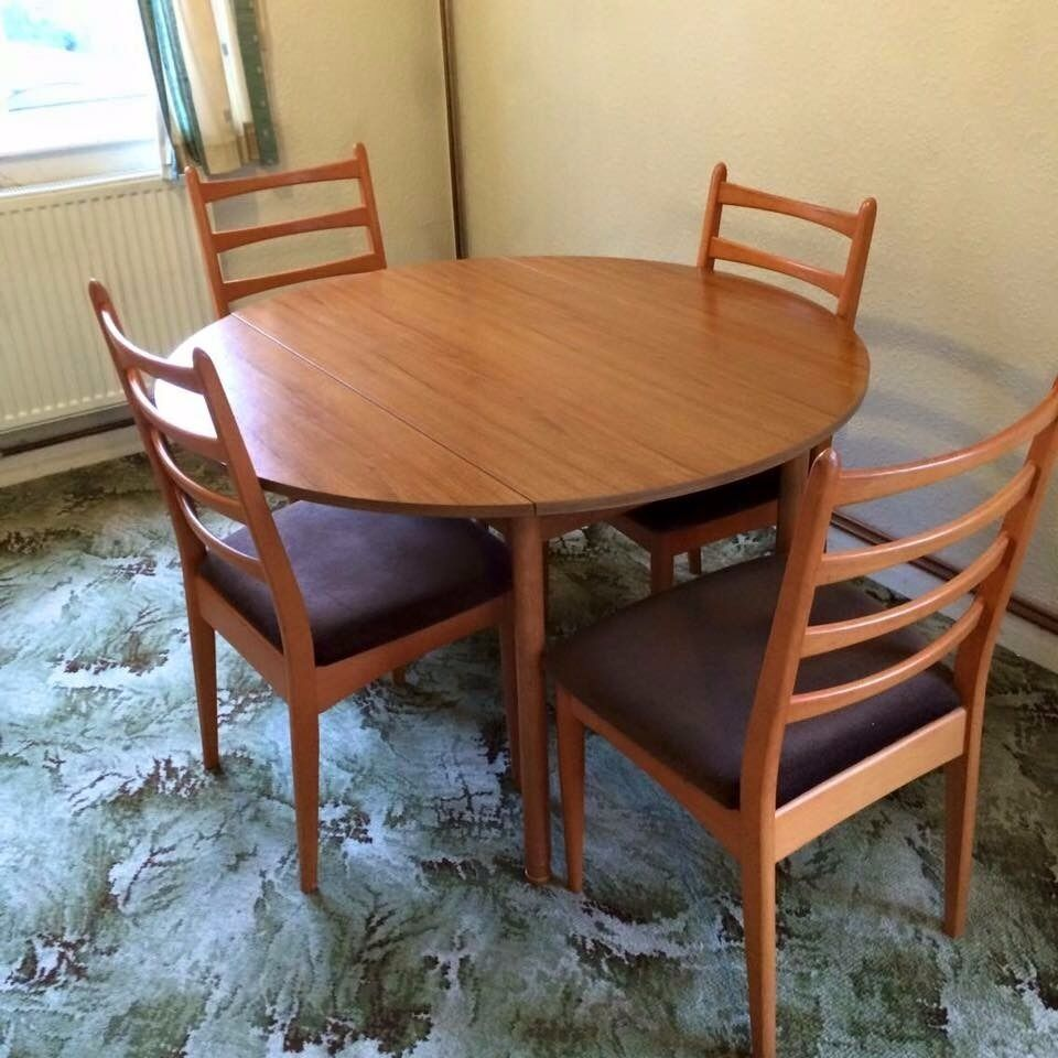 Dining table with 4 chairsin Littleover, DerbyshireGumtree - Dining table with 4 chairs as seen in the picture. The table as some marks due to use but will be perfect with a tablecloth. The table can be reduced and the legs are removable for easy transport. Needs collection