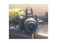 Nikon D5100 DSLR with 18-55mm VR DX Lens wifi Memory