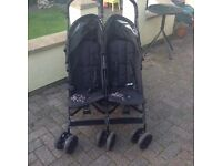 Double pushchair and raincover