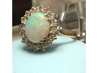 Beautiful opal and diamond cluster ring. 16 round diamonds 1.14ct. 18ct gold.