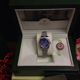 ladies - Rolex Datejust with silver bracelet and blue patterned face All comes in Rolex bag & box