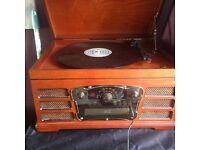 Vinyl Player, Tape, CD, Aux & Radio.