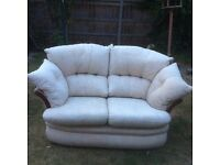 Two seater sofa - cream - perfect for a conservatory or an alcove