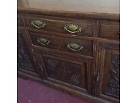 Vintage sideboard with beautiful carvings and original hardware.