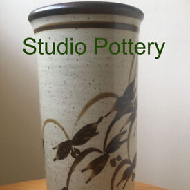 Heavy, tall, hand-thrown, studio pottery vase, stylised fuschia flowers design on one side. £6 ovno