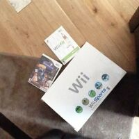Wii system in box with 2 games