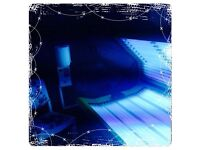 Two large sunbeds with safe tubes & facial boosting tubes
