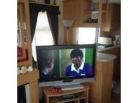 BARGAIN BREAKS ... SANDYLANDS ... 3 BEDROOM FAMILY CARAVAN ..£75. SECURITY..