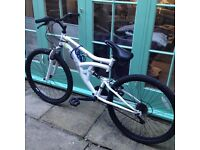 Full suspension mountain bike. Excellent condition, 18 speed shimano gears.