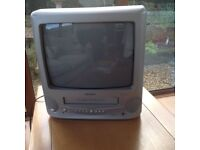 TV with video player, Freeview box, wall bracket & videos