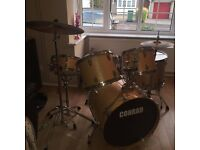 "Used Conrad drum kit with Sabian B8 cymbal set (14"" hi-hat, 16"" and 20"" ride cymbal)"