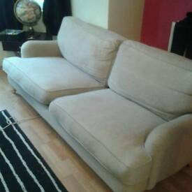 Three seater sofa and matching armchair