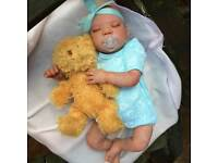 New reborn doll will come with clothes of my choice