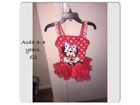 Minnie Mouse swimming costume.
