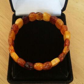 Genuine amber braclet in multi tones from honey to deep orange, elasticated