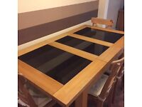 Solid oak dining table and 4 black leather chairs for sale
