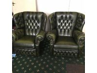 Selling a pair of green leather club chairs. In good condition.