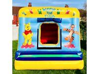 Winnie the pooh bouncy castle 12ft x 12ft