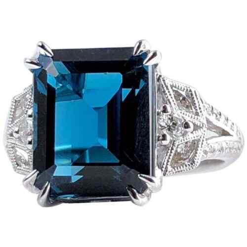 Features Gorgeous 8.34CT Emerald Cut Vivid Blue Topaz & White CZ Solitaire Ring