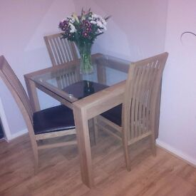 Dining table and 4 chairs, glass topped