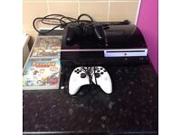PS3 160 GB (NOT SLIM) Comes with two controllers and two games.