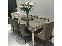 Mirrored 8 seater dining table and chairs, fantastic condition!
