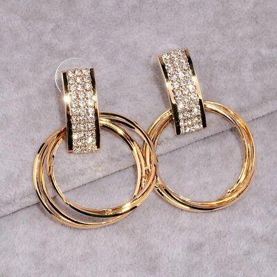 Stunning gold tone triple hoop cubic zirconia drop dangle (Gold Cubic Zirconia Drop)