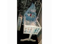 Swinging crib, comes with 4 crib sheets & instructions! Good condition