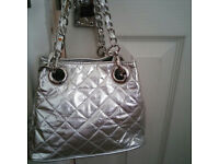 Silver-quilted handbag by River Island