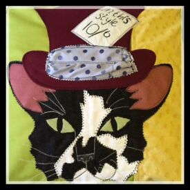 Handmade appliqué mad hatter Cat cushion