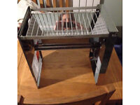 Fold away camping grill/bbq - brand new