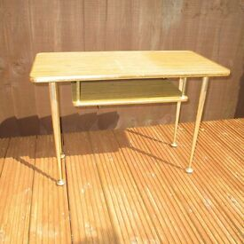 Vintage retro atomic styled 1960s coffee table with magazine shelf.