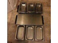 Silver table food warmers and dishes