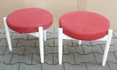 2 round the 60er Stappelhocker with Red Fabric Cover