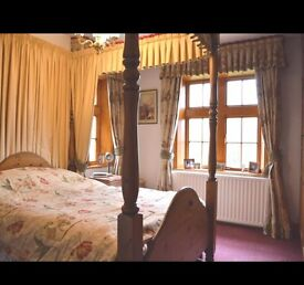 Solid wooden four poster double bed