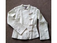 Mandarin light quilted jacket. H&M Size 8. Cream with satin detail fasteners.