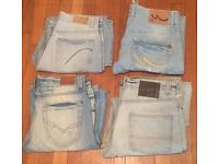 4 pairs of worn men's sandblasted jeans. Waist sizes 32/33/34. All in good condition