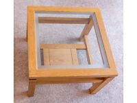 Light oak, solid wood coffee/lamp table with inlaid glass top and shelf
