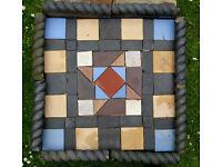 Victorian reclaimed floor tiles/garden feature + ropetwist edging tiles