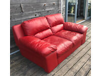 Red leather DFS two seater sofa