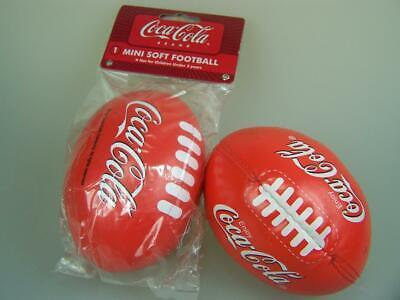 Two different Coke Coca-cola mini soft footballs